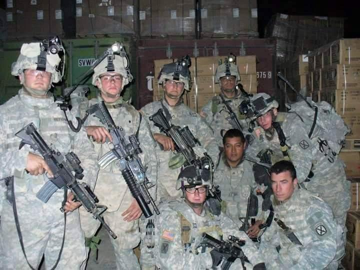 John Moynihan can be seen far left in this photograph taken in Iraq.
